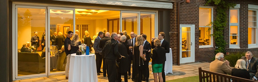 Guests enjoying an event at the Royal Sydney Golf Club in the evening