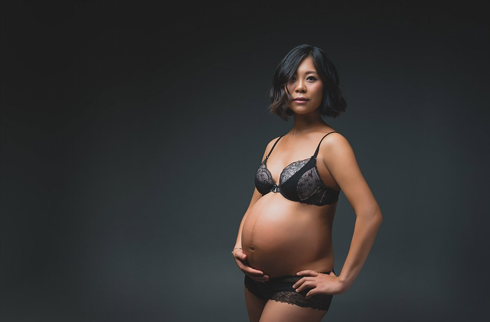 Pregnant woman low key in lingerie hands on hips in Sydney studio