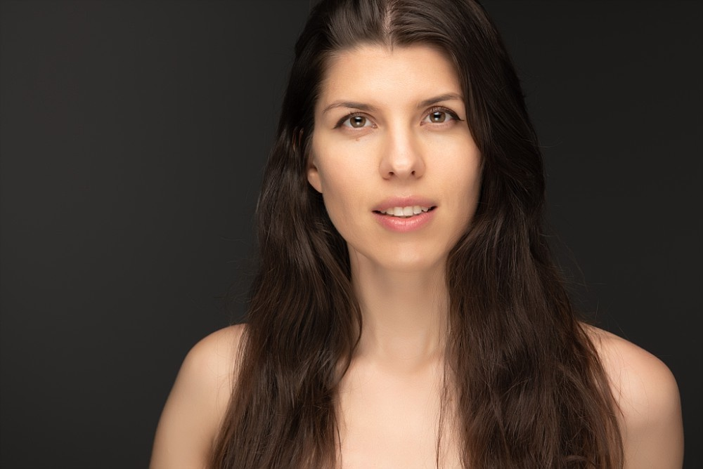 Beauty headshot of woman with dark hair in Sydney studio