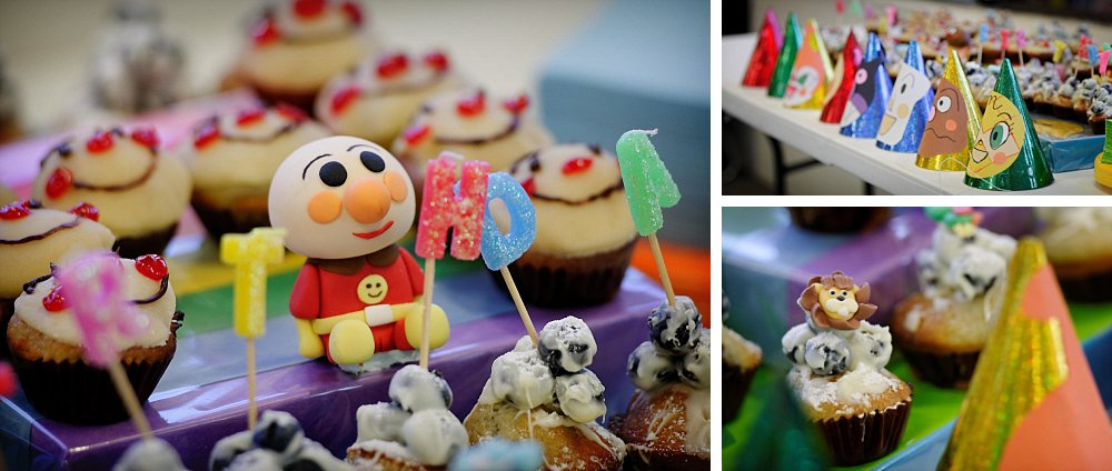 Close-up of Anpanman cake decorations and party hats in Chatswood