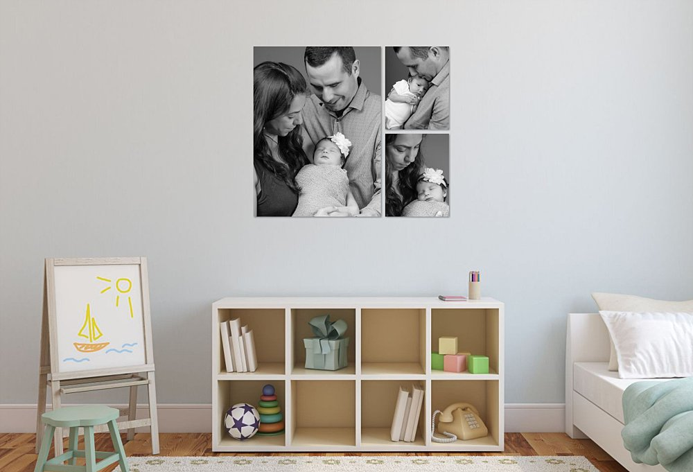 Artwork in playroom of parents with newborn baby girl in wrap