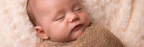 Newborn baby boy sleeping in studio photography session in Sydney