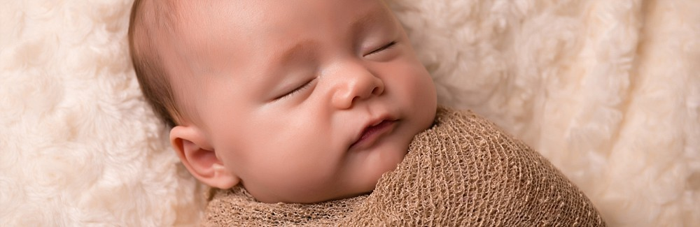 Newborn baby boy sleeping in studio photography session in Sydney