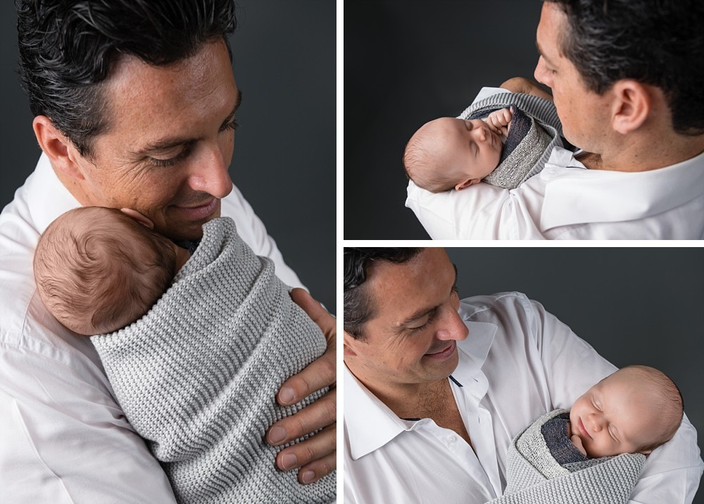 Dad and baby wrapped in Sydney studio on grey background