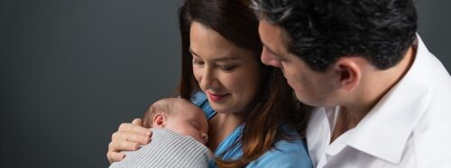 Italian parents and month old baby wrapped in Sydney studio photography session