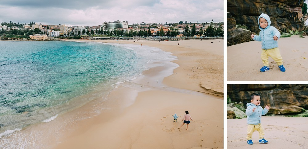 Wide view of 1 year old boy and mother at Coogee Beach Sydney