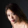 Young Asian woman with long hair in Sydney studio