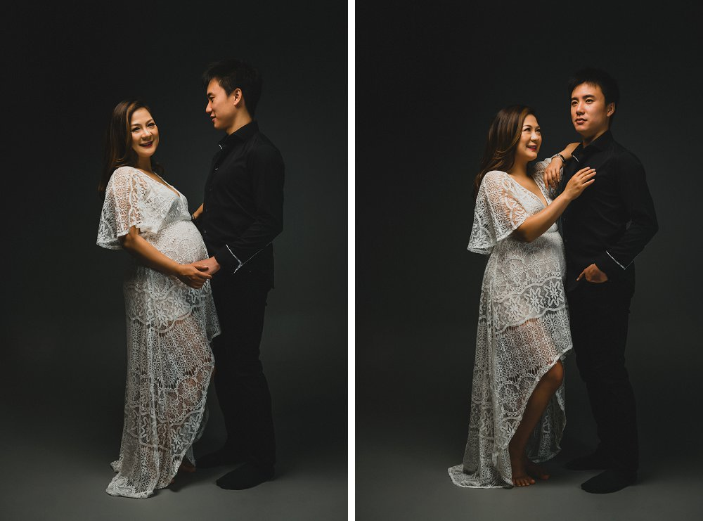 Pregnant couple standing in Sydney studio on dark grey background