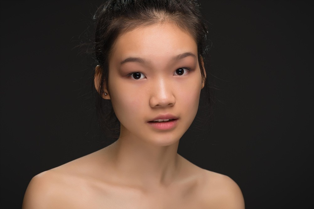 Beauty headshot of young Asian woman in Sydney studio