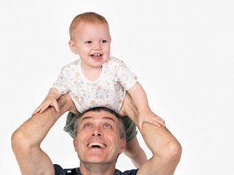 Toddler on dad's head in Coogee Kids photo session with white studio background