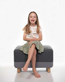 Girl sitting in Coogee Kids photo session with white studio background
