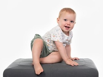 Toddler sitting in Coogee Kids photo session with white studio background