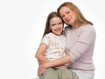Mother & child sitting in Coogee Kids photo session with white studio background