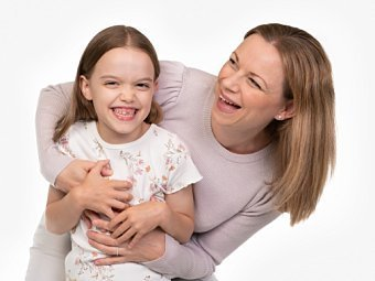 Mother & child laughing in Coogee Kids photo session with white studio background