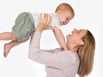 Mother & toddler laughing in Coogee Kids photo session with white studio background