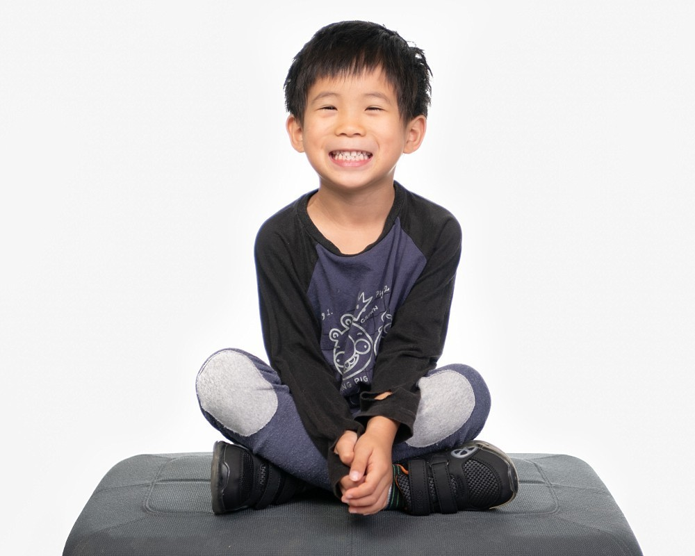 Child sitting in Coogee Kids photo session with white studio background