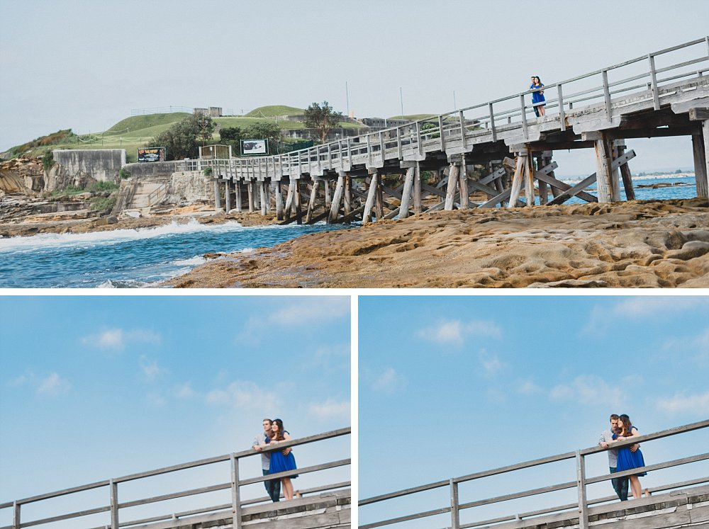 Pregnant couple standing on wooden bridge at La Perouse Barefort Island