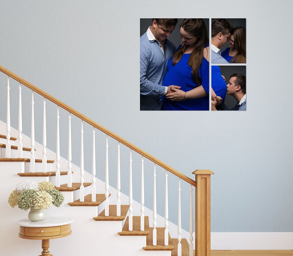 Artwork on staircase of pregnant Caucasian couple