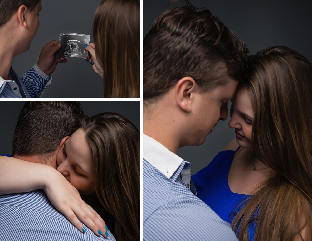 Caucasian couple in Sydney studio looking at ultrasound and hugging