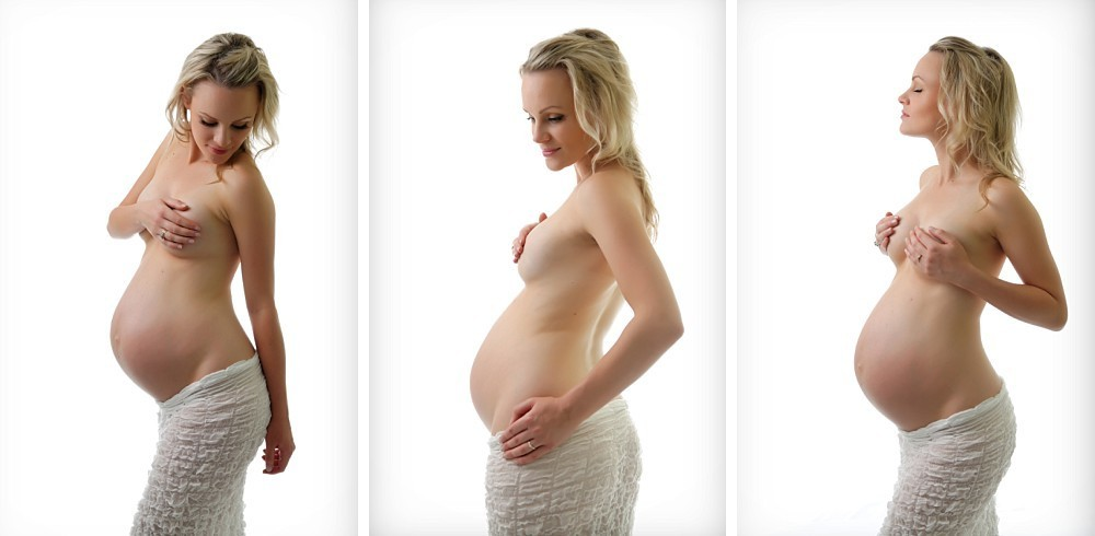 Nude pregnant woman covering breasts in Sydney photography studio