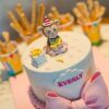 Birthday cake with monkey on top