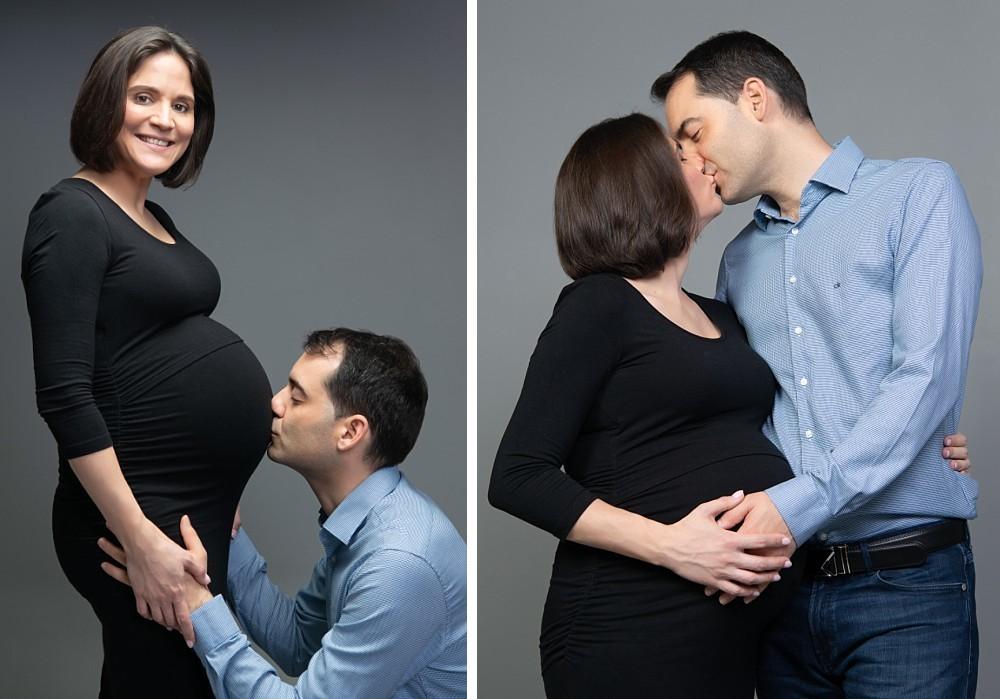 Pregnant Caucasian Pregnancy couple kissing in studio