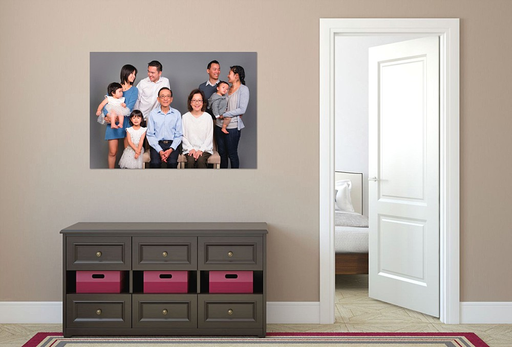Canvas artwork of Asian extended family on wall in hallway