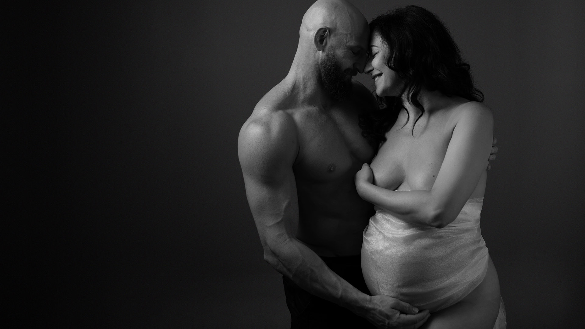 Couple in pregnancy boudoir photo session Sydney
