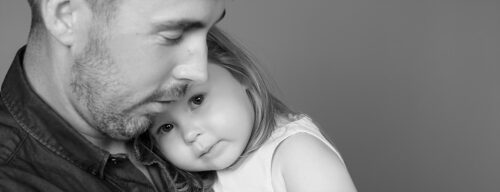 Father holds 2yr old daughter emotional moment in Sydney studio