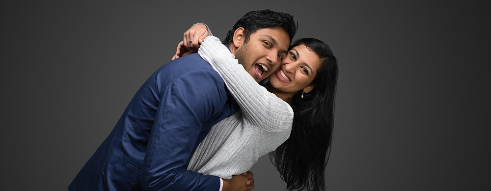 Young Indian couple smiling hugging in Sydney studio beloved photography