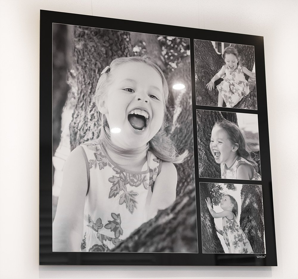 Metal artwork of 4 year old girl playing in tree laughing