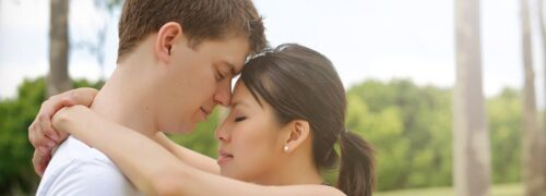 Romantic couple hugging her arms around his neck in Sydney Photography Session