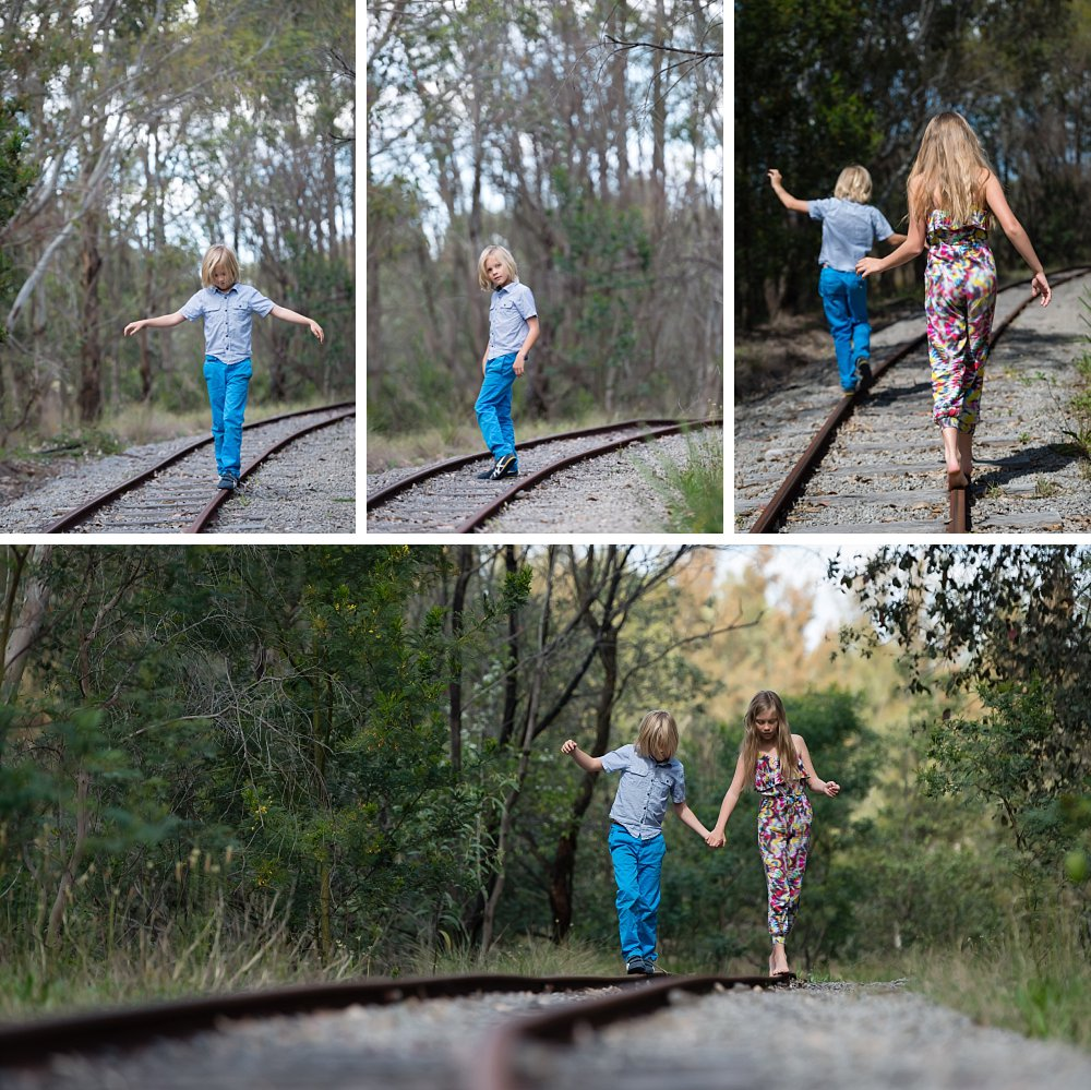 Boy and girl walking balancing on abandoned tracks at Sydney Olympic Park