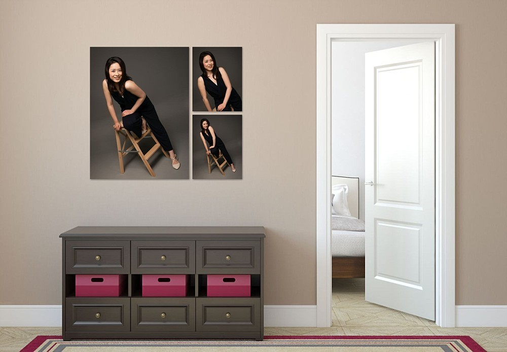Canvas artwork collection of young woman on wall in hallway
