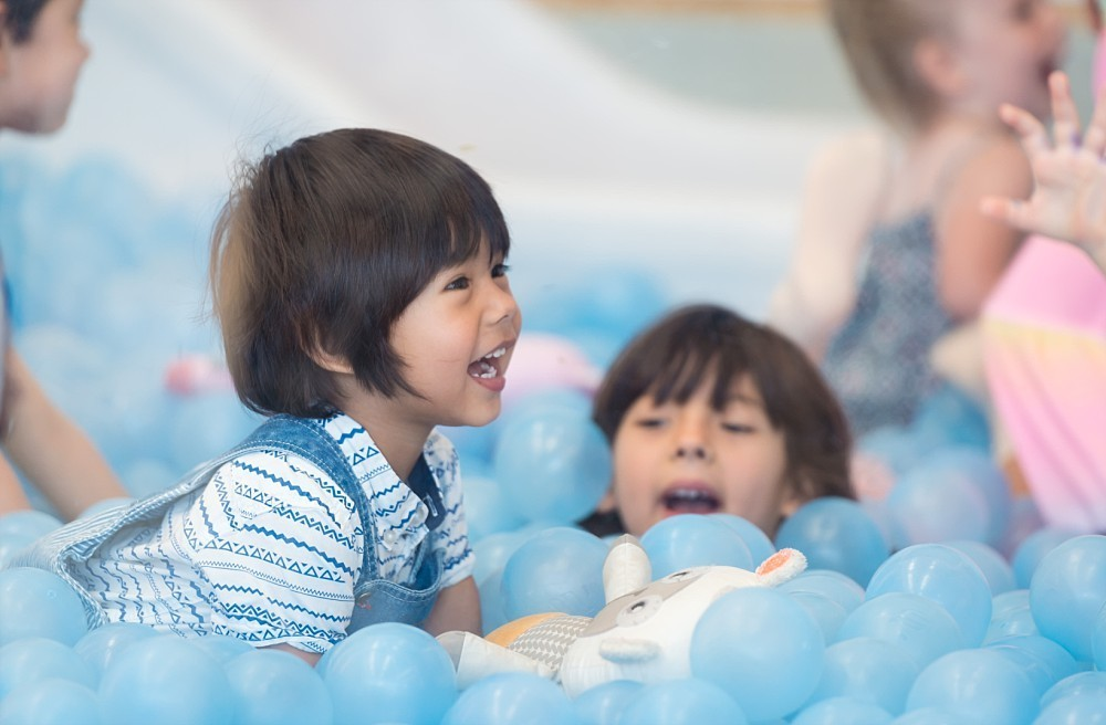 Young boy playing in ball pit at Nubo Sydney