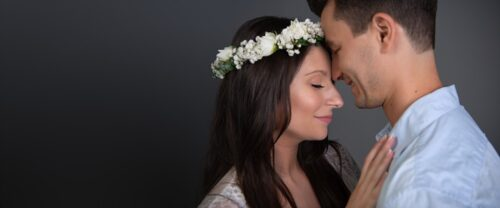 Loving couple with flower crown in Sydney studio