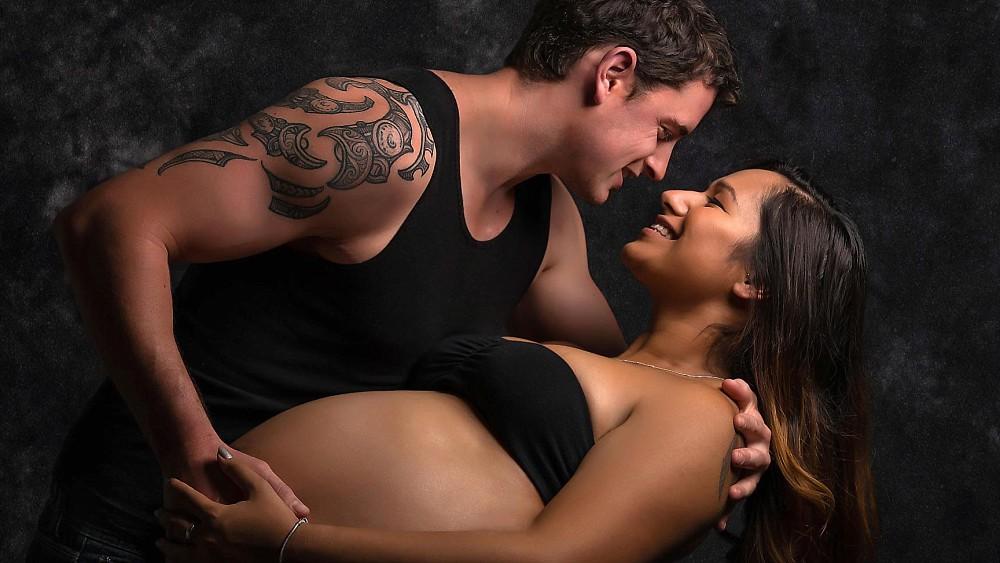 Pregnant couple boudoir session in Sydney studio