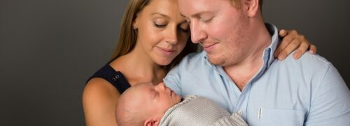 Caucasian couple with newborn baby in Eastern Suburbs studio