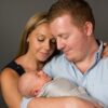 Caucasian couple with newborn baby in Eastern Suburbs studio