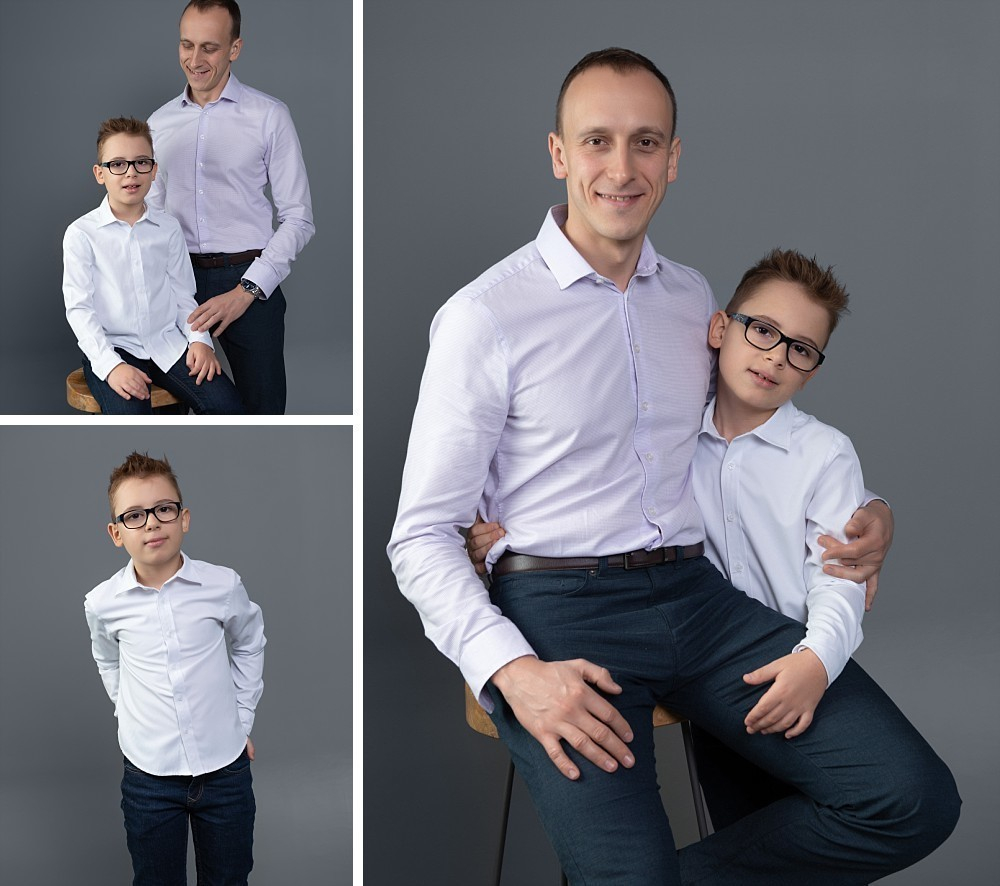 Young boy with glasses and proud dad in in Sydney studio photography session